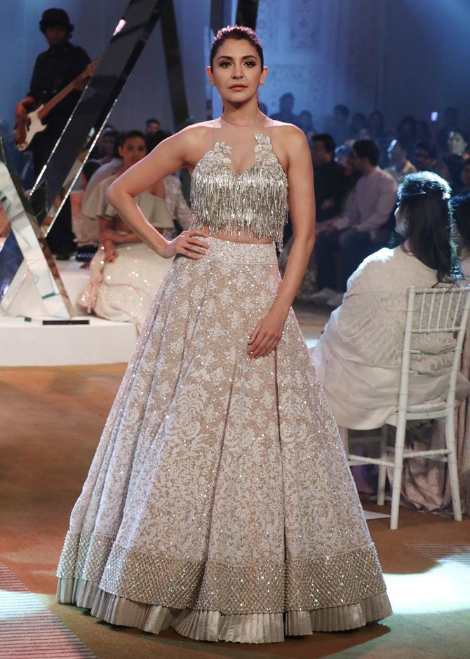 Anushka's wedding attire which was also exclusively designed by ace designer Sabyasachi Mukherjee