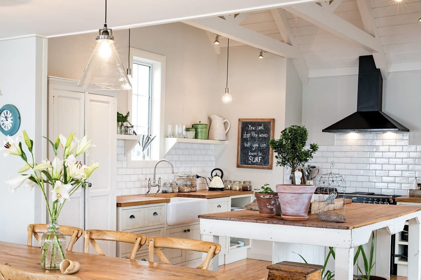 Some ways to work it in include doing up a feature wall using wood panels or as a trimming to a kitchen opening