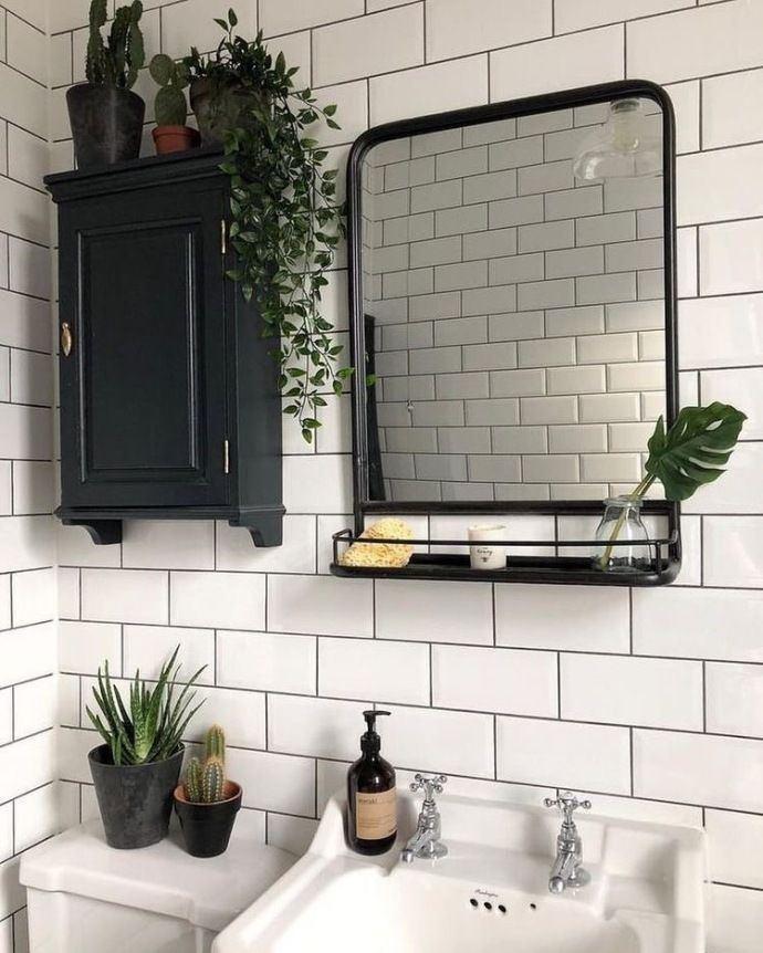 Bathroom vanity and unframed mirror