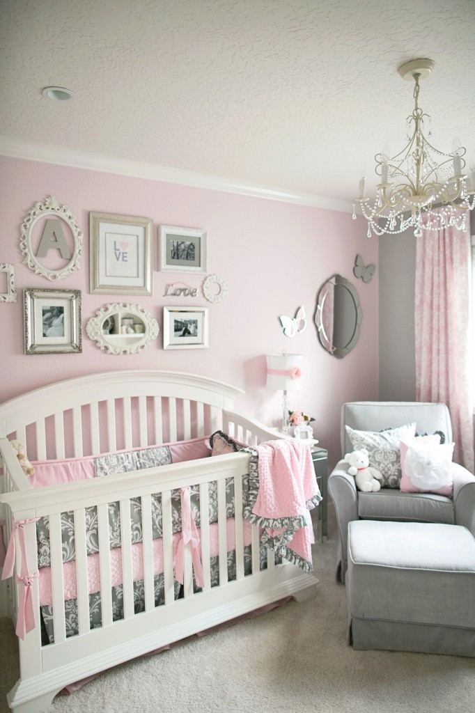 This timeless toddler girls bedroom features lovely white and purple flower  wall decorations and a matching gingham bedspread