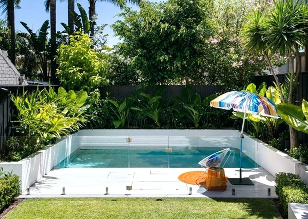 Garden and Patio, Small Backyard Lazy River Pool Design With Stone Liner And Lounge Area Beside Stone Waterfall Plus Wooden Bridge Ideas ~ Backyard Lazy