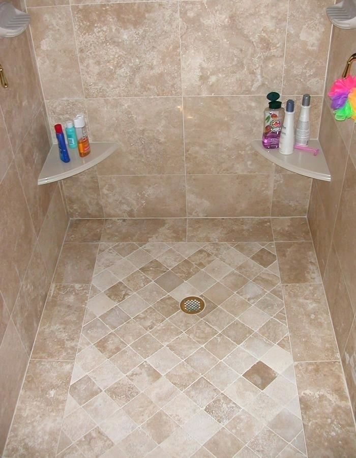 The shower is enclosed in travertine and topped with a skylight