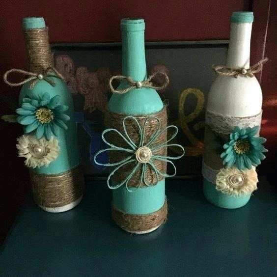 Paint with glass paint, decorate neck and bottom  with gold or silver string