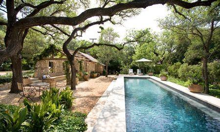 Modern backyard swimming pool with hot tub