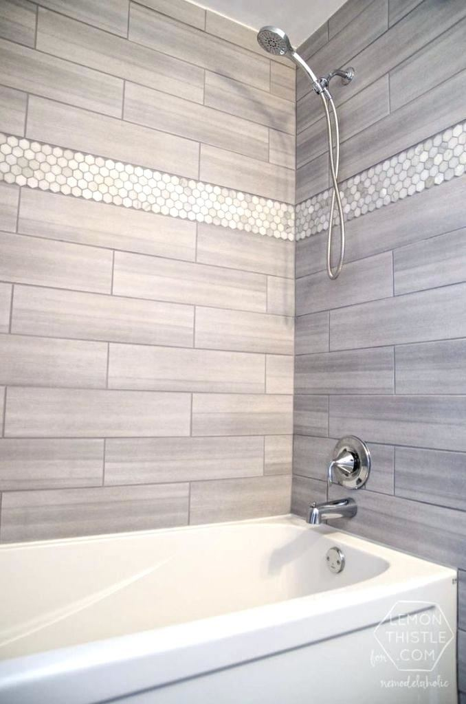 Shower with shower glass and bench in guest bathroom