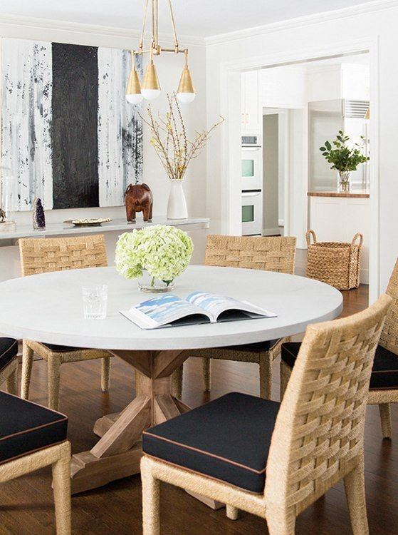In the dining room 1950s Jacques Adnet chairs join a 19thcentury English table