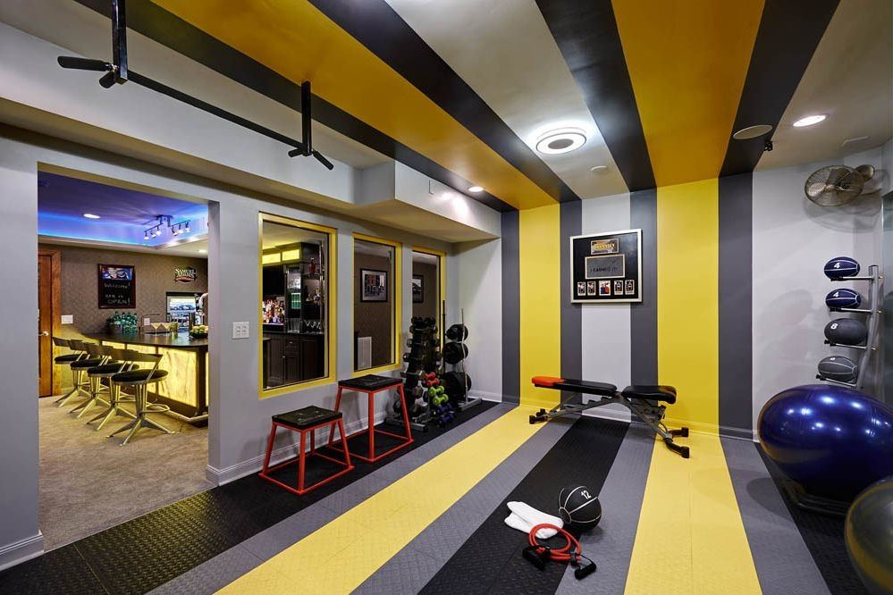 Fitness room with weights on shelves