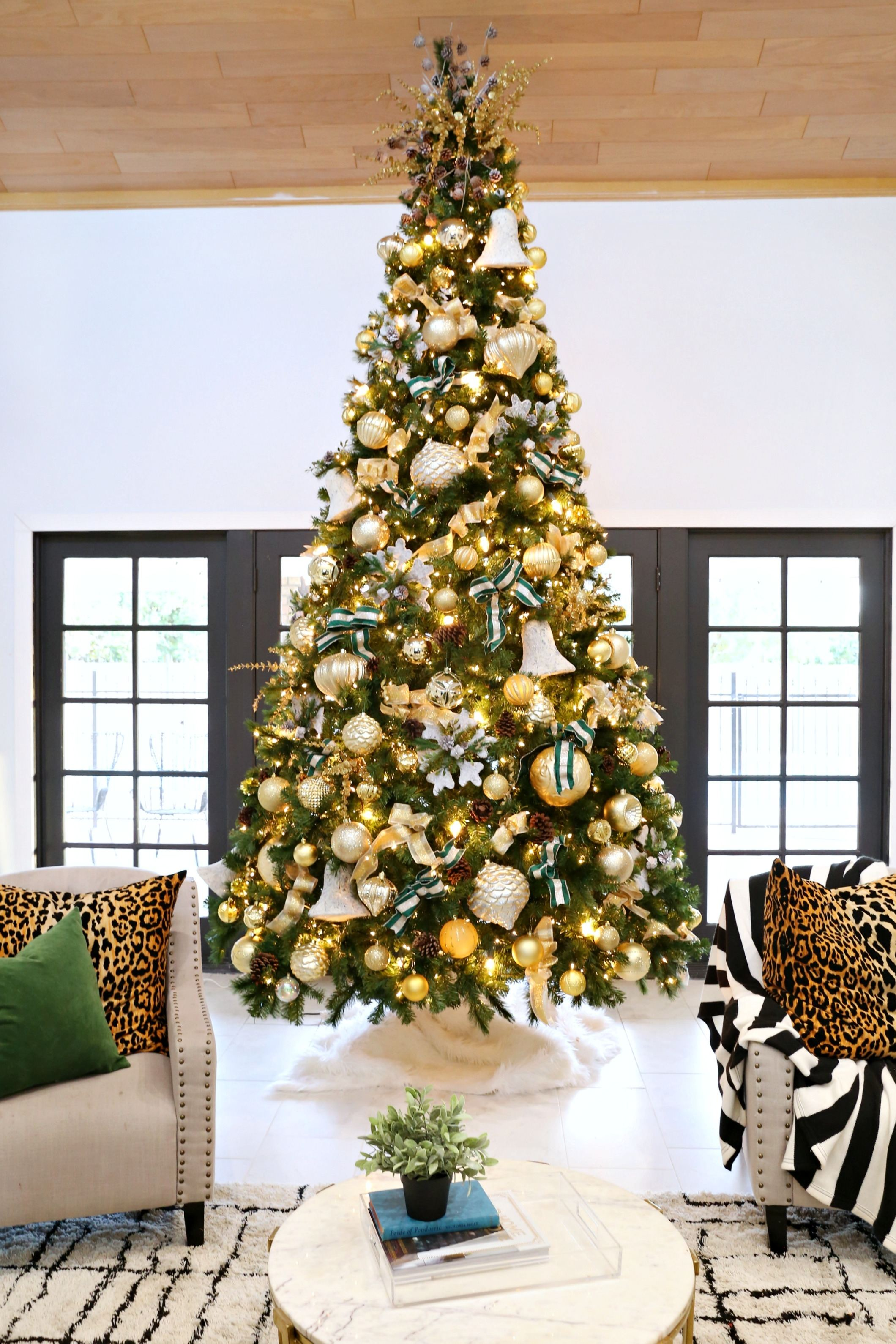 This elegant Christmas tree beautifully mixes oversize ornaments  with