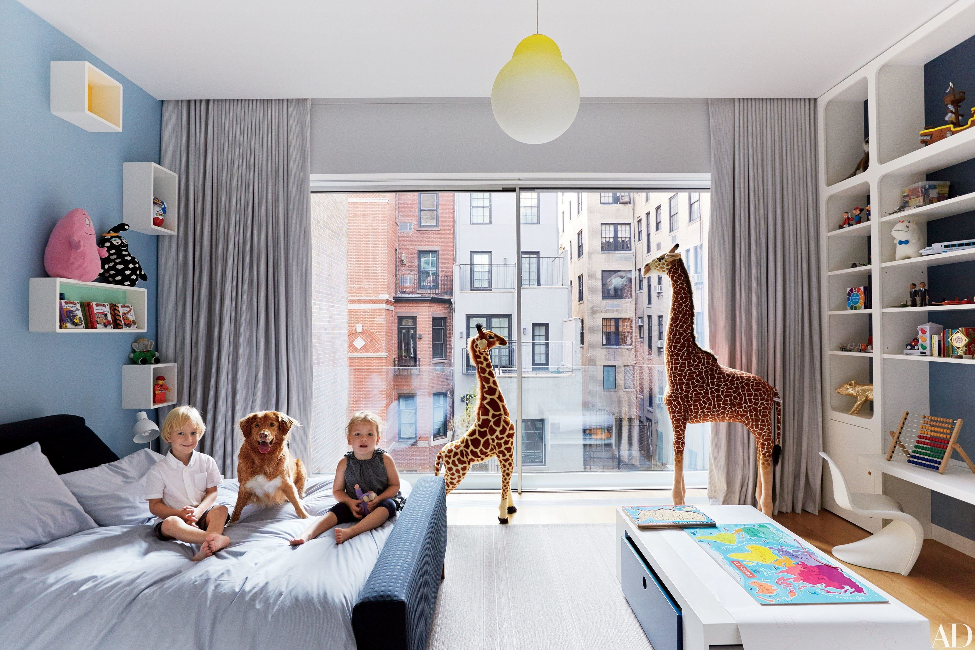 Make your toddler feel like a big boy by choosing sophisticated colors like  the monochromatic scheme found in this room