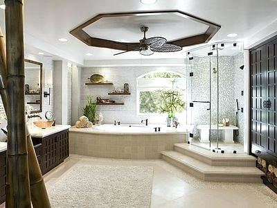 The stylish master bath is a mix of beautifully patterned porcelain tiles  and wood