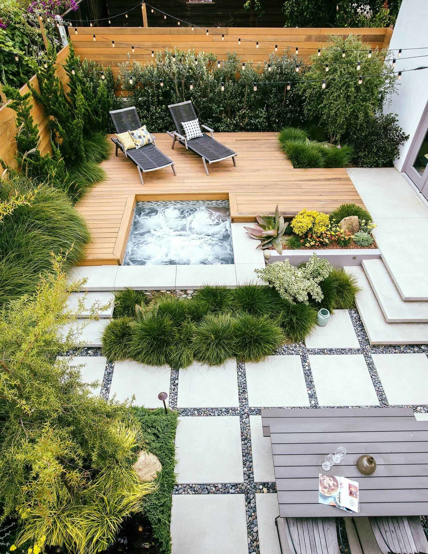 This backyard was made for relaxation, from the redwood deck and hot tub to the lush foilage that creates a tropical oasis