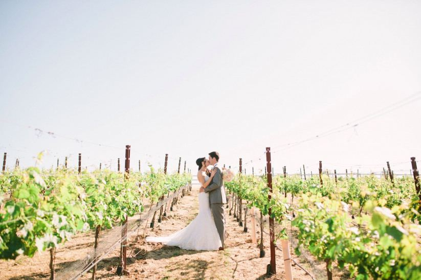 Temecula outdoor wedding at falkner winery bride mermaid style gown with  lace bodice and sweetheart neckline
